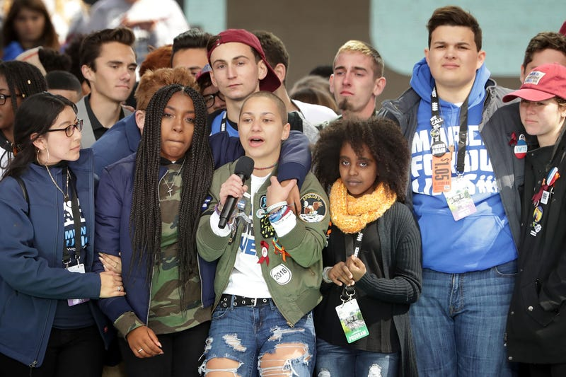 Students from Parkland, Fla.'s Marjory Stoneman Douglas High School, including Emma González (center), stand together onstage with other young victims of gun violence at the conclusion of the March for Our Lives rally on March 24, 2018, in Washington, D.C.