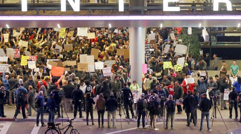 Protestors demonstrate against Trump's Muslim ban at LAX on Jan. 28, 2017. Image via AP Photo.