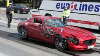 Illustration for article titled Day-old Mercedes SLS AMG crashes into bus