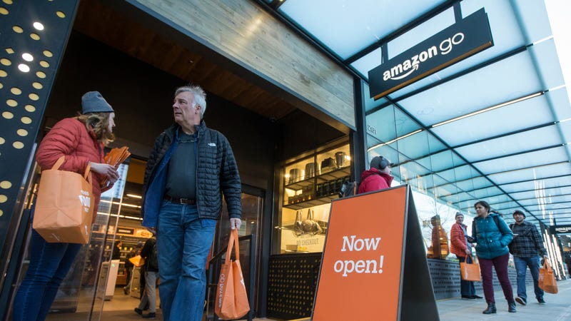 """A shopper walks out the the Amazon Go store, on January 22, 2018 in Seattle, Washington. After more than a year in beta Amazon opened the cashier-less store to the public."""