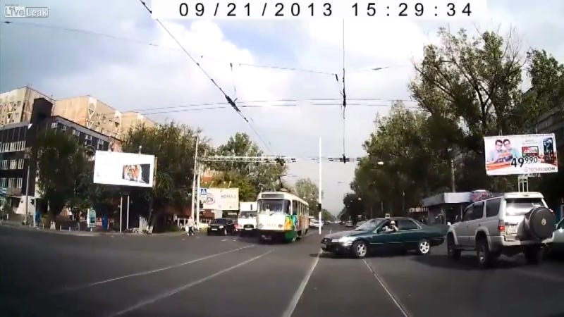 Illustration for article titled Watch A Road-Raging Asshat Get Instant Karma Via A Tram