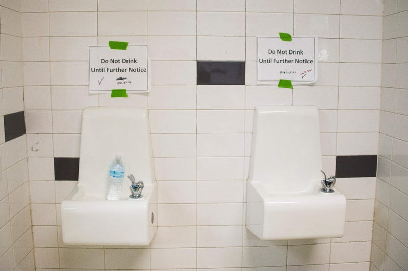 Placards posted above water fountains warn against drinking the water at Flint Northwestern High School in Flint, Mich., on May 4, 2016. (Jim Watson/AFP/Getty Images)