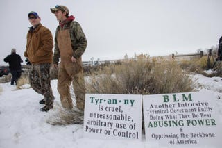 Members of an armed anti-government militia monitor the entrance to the Malheur National Wildlife Refuge headquarters near Burns, Ore., Jan. 5, 2016.ROB KERR/AFP/Getty Images