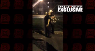 The unidentified cop allegedly taking money from Lamard JoyeThe New York Daily News