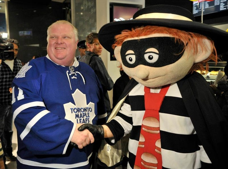 Illustration for article titled Rob Ford In A Maple Leafs Jersey Posing With The Hamburglar?