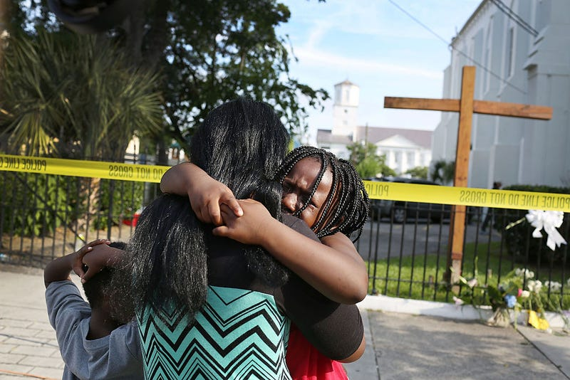 Kearston Farr comforts her daughter, Taliyah Farr, 5, as they stand in front of the Emanuel African Methodist Episcopal Church in Charleston, S.C., after a mass shooting at the church that killed nine people on June 19, 2015. (Joe Raedle/Getty Images)