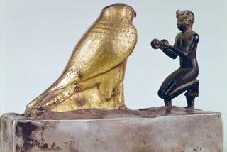 Nubian. Pharaoh Taharqa offering wine to the god Hemen, circa 685 B.C. Bronze, gold-plated stone on base of silver-plated wood, 19.7 cm.The Louvre, Paris