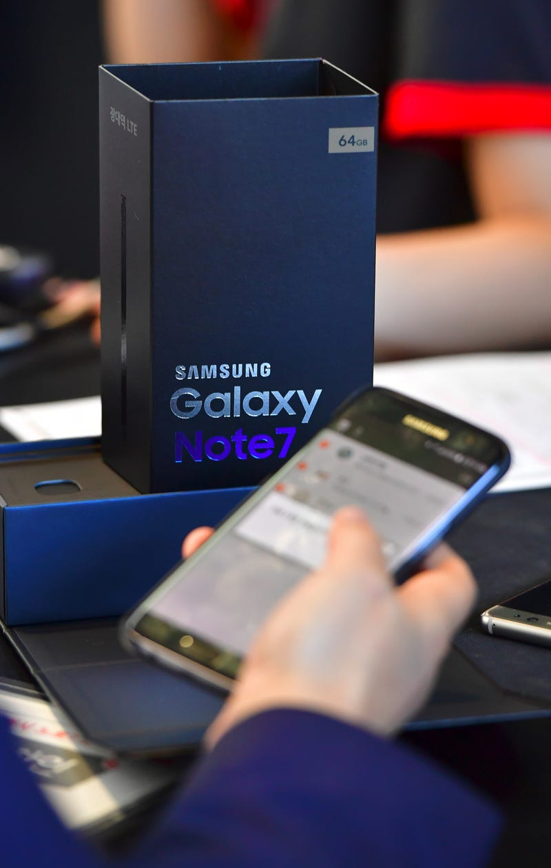 A man checks his Samsung Galaxy Note7 smartphone at a telecommunications shop in Seoul, Korea, on Sept. 19, 2016.JUNG YEON-JE/AFP/Getty Images