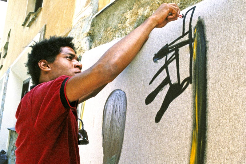Artist Jean-Michel Basquiat paints in 1983 in St. Moritz, Switzerland.
