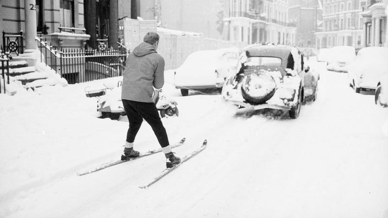 A skier being pulled behind a car in Earl's Court, London. (Photo: Terry Fincher & Michael Stroud/Express/Getty Images)