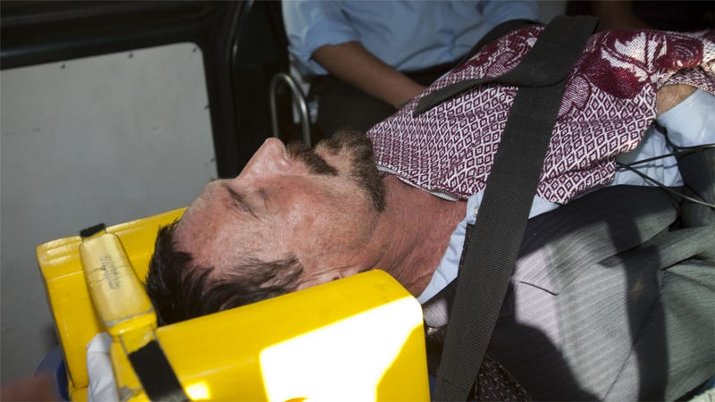 Illustration for article titled Here's John McAfee, in Restraints, Headed To a Guatemalan Hospital