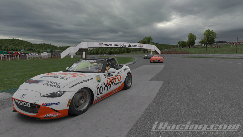 The Team Oppo Miata piloted by bwp240 races through Turn 1 at Lime Rock