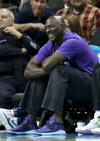 Michael Jordan, now owner of NBA's Charlotte Hornets, watches a game from the bench April 25, 2016, in Charlotte, N.C. Streeter Lecka/Getty Images