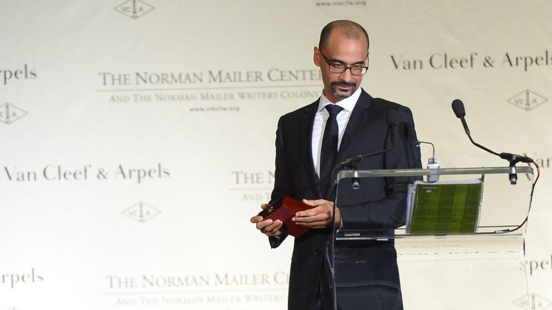 Author Junot Diaz accepts an award at the Norman Mailer Center's Fifth Annual Benefit Gala on October 17, 2013, in New York City.