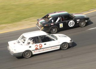 Illustration for article titled End Of Day One: It's Your Typical Civic vs Volvo 240 vs Alfa Romeo Milano Race!