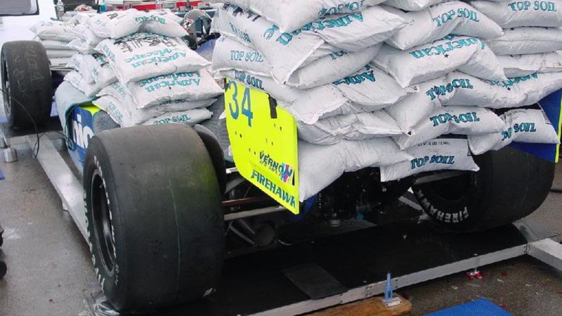 Here's Why There's 4,000 Pounds Of Manure Stacked On This Racecar
