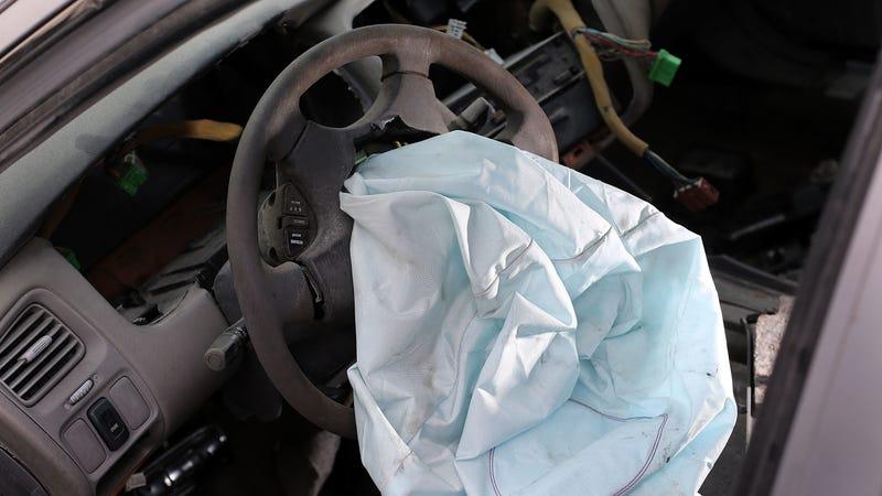 An airbag deployed on a 2001 Honda Accord.