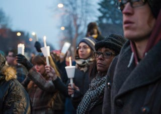 Protesters, activists and community members listen to a speech by Nekima Levy-Pounds, Minneapolis NAACP president, at a candlelight vigil held for Jamar Clark outside the 4th Precinct Nov. 20, 2015, in Minneapolis.Stephen Maturen/Getty Images