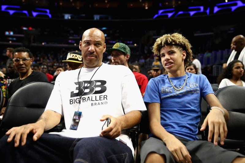 LaVar Ball and LaMelo Ball look on from the audience during week 8 of the Big3 three-on-three basketball league at Staples Center in Los Angeles on Aug. 13, 2017. (Sean M. Haffey/Getty Images)