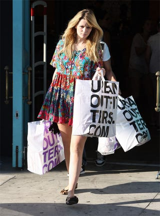 Illustration for article titled Mischa Barton Stocks Up On Big Bags, Budget Fashions