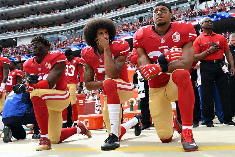 Eli Harold, Colin Kaepernick and Eric Reid, all then of the San Francisco 49ers, kneel on the sideline during the anthem prior to the game against the Dallas Cowboys at Levi's Stadium on Oct. 2, 2016, in Santa Clara, Calif.
