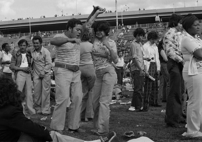 """Dancers, Randall's Island, c. 1974. Photograph by José """"Yogui"""" Rosario. Courtesy of José """"Yogui"""" Rosario and Pablo E. Yglesias."""