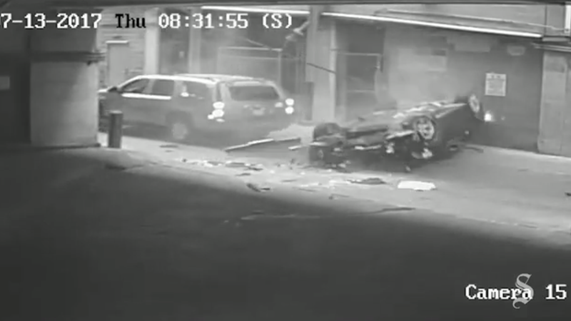 BMW plunges 7 stories from Texas parking garage; crashes into alley