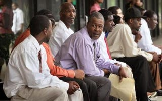 Job seekers on break at a job fair (Getty Images)