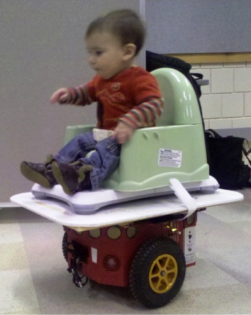 Illustration for article titled Chair + Wii Fit  Balance Board + Wheeled Robot = One Happy Baby