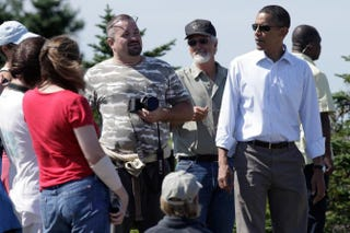 President Barack Obama speaks with visitors at Cadillac Mountain in Acadia National Park in Bar Harbor, Maine, on July 16, 2010.YURI GRIPAS/AFP/Getty Images
