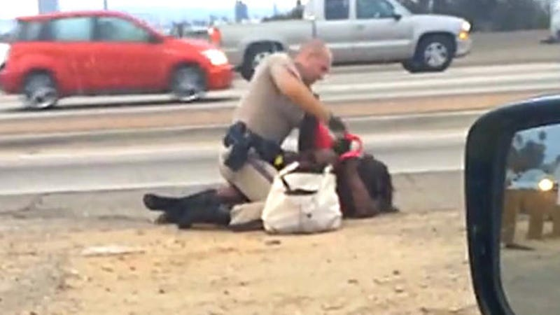 Illustration for article titled ​Horrific: Cell Phone Video Shows California Cop Beating Woman