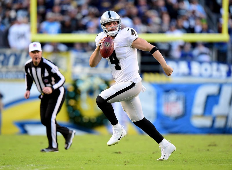 Derek Carr, still doing that thing with his tongue in a game last December. Photo: Harry How/Getty Images
