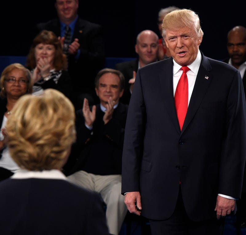 Republican presidential nominee Donald Trump (right) and Democratic presidential nominee Hillary Clinton stand in front of the audience during the second presidential debate Oct. 9, 2016, at Washington University in St. Louis. SAUL LOEB/AFP/Getty Images
