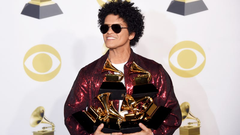 Bruno Mars poses with the five Grammys he won during the 60th annual show Jan. 28, 2018, in New York City.
