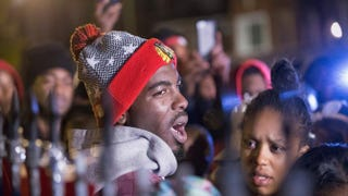 Pierre Stokes, the father of 9-year-old Tyshawn Lee, speaks to supporters during a candlelight vigil held outside his home in memory of his son on Nov. 5, 2015, in Chicago.Scott Olson/Getty Images