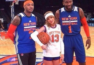 Illustration for article titled Oh Nothing, Just Taylor Swift Hanging Out With Her Pals From The Knicks