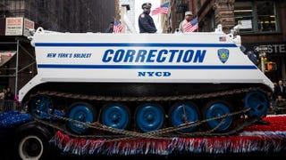 Members of the New York City Department of Correction ride in an armored vehicle during the Veterans Day Parade Nov. 11, 2013, in New York City. Andrew Burton/Getty Images