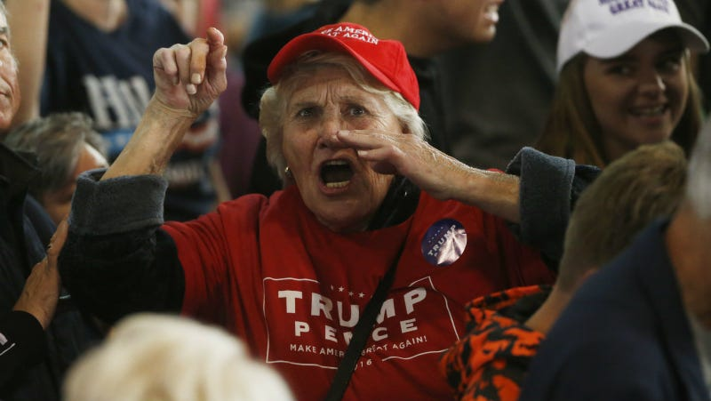 A Trump supporter berates the media as she leaves a campaign rally for Trump, Tuesday, Oct. 18, 2016, in Colorado Springs, Colo. Photo via AP
