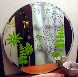 You can easily add patterns or shapes to windows and mirrors using a simple  DIY stencil and some cheap paint.