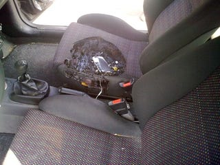Illustration for article titled Flaming iPhone 3G Melts a Crater In This Car Seat