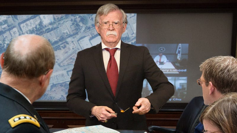 Illustration for article titled Aides Request John Bolton Please Stop Setting Fire To Middle East Tactical Map