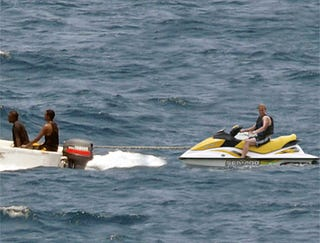 Illustration for article titled Somali Pirates Tow Guy With Stalled Jet Ski