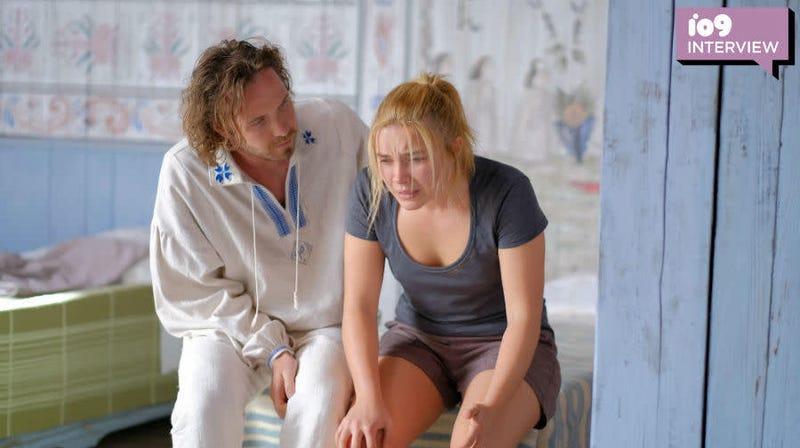 Pelle (Vilhelm Blomgren) reassures a distraught Dani (Florence Pugh) in Midsommar.