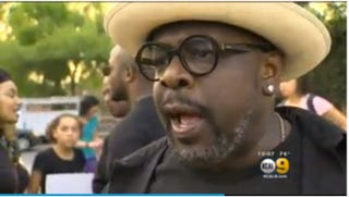 Cedric the Entertainer helps to lead a march against the police killing of black men in Hollywood, Calif., on Sept. 28, 2016. KCAL-9 Screenshot