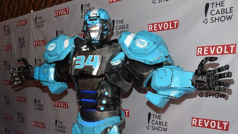 Don't let those hugging arms fool you; Cleatus, the Fox NFL Robot, knows no mercy