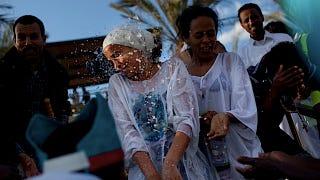 Illustration for article titled Christian Women Baptized in the Jordan River