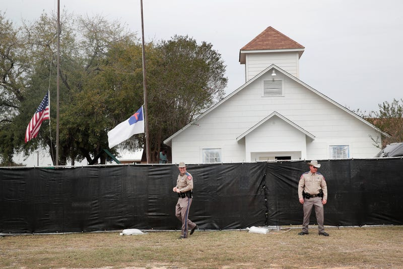 Police keep watch outside the First Baptist Church of Sutherland Springs in Texas after it was surrounded by a tarp on Nov. 9, 2017, in the wake of a fatal mass shooting there.  (Scott Olson/Getty Images)