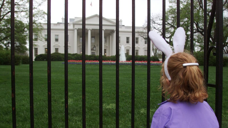 6 year old Rachel Kelmartin stands in front of the White House after learning the annual Easter Egg Roll on the South Lawn was cancelled due to rain, April 16, 2000. Photo via Getty Images.