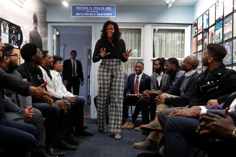 Former first lady Michelle Obama surprises students from Wayne State University during a discussion at the Motown Museum in Detroit, Tuesday, Dec. 11, 2018.