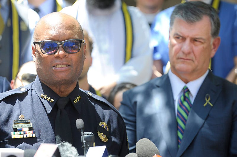 Dallas Mayor Mike Rawlings, right, listens as Dallas Police Chief David Brown talks at a prayer service at Thanksgiving Square in Dallas on July 8, 2016. Max Faulkner/Fort Worth Star-Telegram/TNS via Getty Images